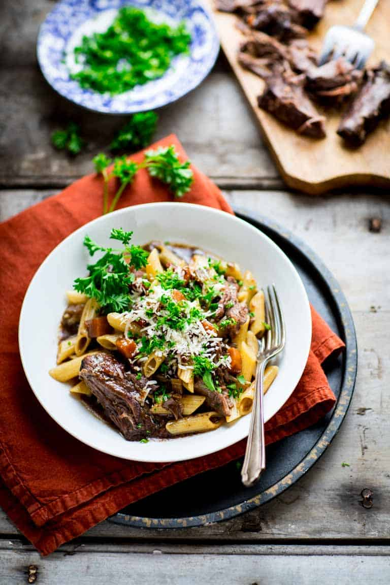 Slow Cooker Beef Chuck with pasta topped with parsley in a bowl