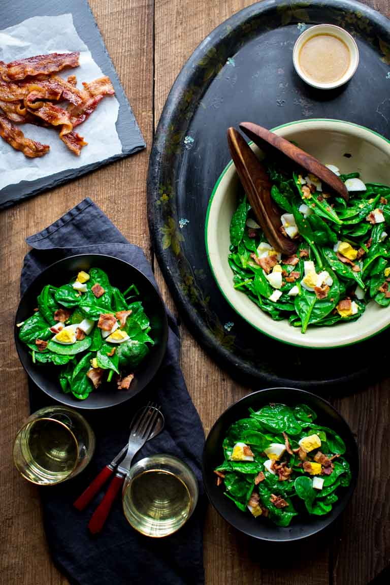 Top a bunch of vibrant and crisp spinach with bacon and eggs, toss it with a rockin' red wine vinaigrette and call it Spinach Salad with Bacon & Eggs! It's dairy-free, only 248 calories per serving and ready in just 30 minutes. | Healthy Seasonal Recipes | Katie Webster