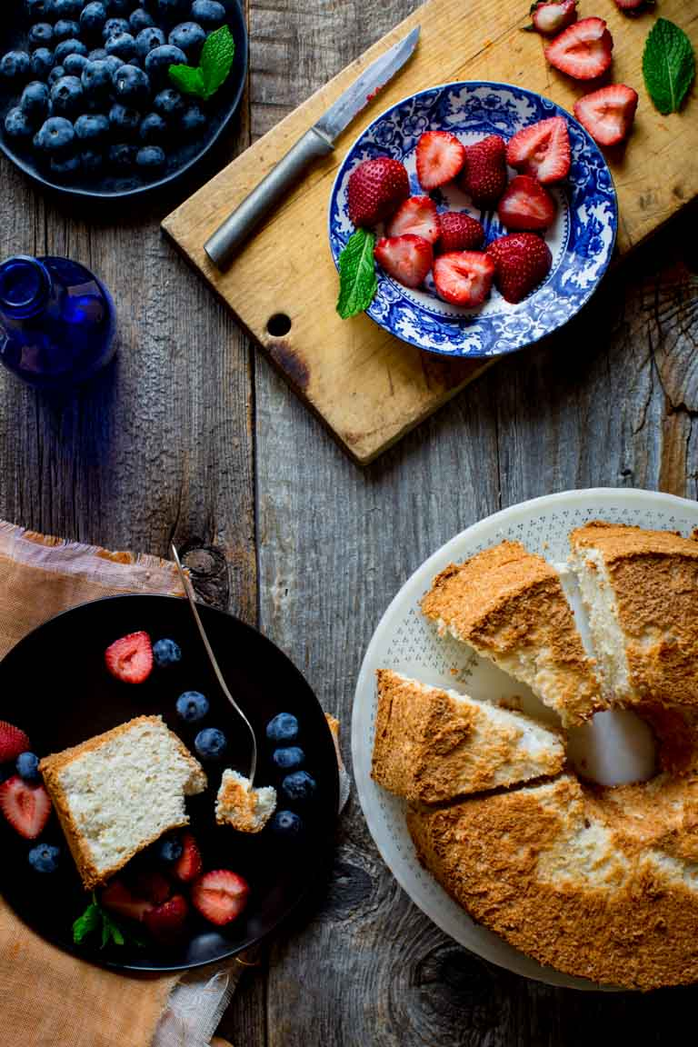 Give me a simple, fresh slice of airy Angel Food Cake piled with fruit and I am in heaven. It is the perfect dessert to end a warm Summer night of grilling and eating outside with your family and friends! | Healthy Seasonal Recipes | Katie Webster
