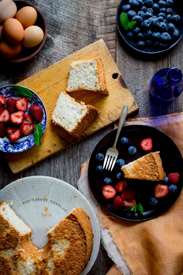 Give me a simple, fresh slice of airy Angel Food Cake piled with fruit and I am in heaven.It is the perfect dessert to end a warm Summer night of grilling and eating outside with your family and friends! | Healthy Seasonal Recipes | Katie Webster