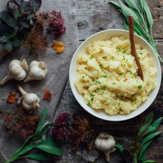 Roasted Garlic Mashed Potatoes may be lighter in calories with non-fat plain yogurt, but they are far from light on flavor with layer upon layer of yummy garlic! | Healthy Seasonal Recipes | Katie Webster