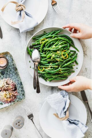 a platter of green beans on a table