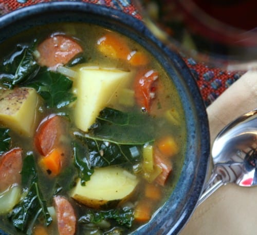 A bowl of soup, with Potato and Kale