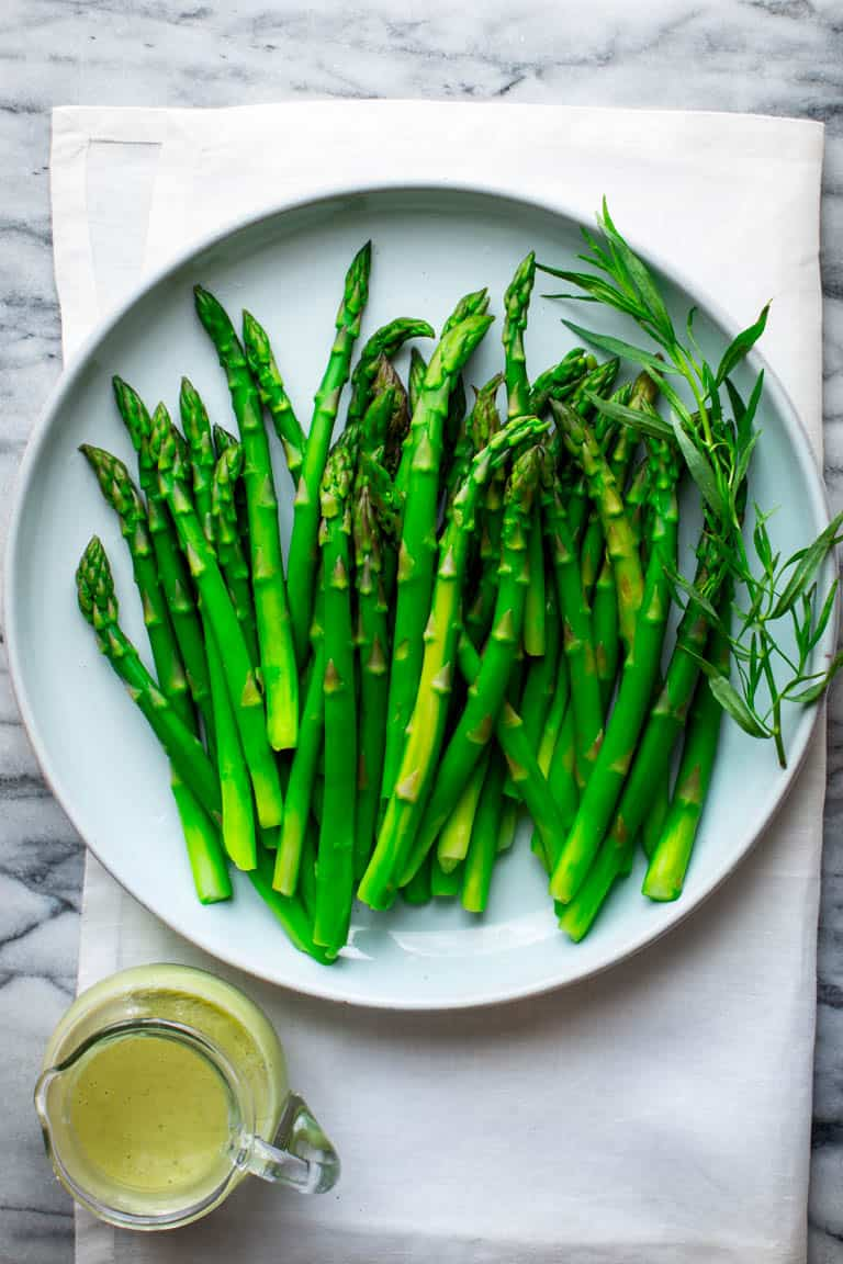 Put this Asparagus with Tarragon Vinaigrette on your Easter brunch menu and you will have more time to spend with your guests and hide those eggs! This is the perfect make-ahead Spring side dish that is ready in under 30 minutes and just also happens to be vegetarian and Paleo friendly! Healthy Seasonal Recipes and Katie Webster