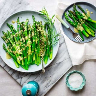 Put this Asparagus with Tarragon Vinaigrette on your Easter brunch menu and you will more time to spend with your guests and hide those eggs! This is the perfect make-ahead Spring side dish that is ready in under 30 minutes and just also happens to be vegetarian and Paleo friendly! Healthy Seasonal Recipes and Katie Webster
