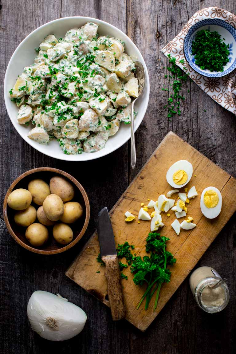 This Creamy Horseradish Potato Salad is a healthier twist on the classic Summer vegetarian side dish and it is mind blowing. It is so creamy and full of flavor that everyone will line up to get a bite! | Healthy Seasonal Recipes | Katie Webster