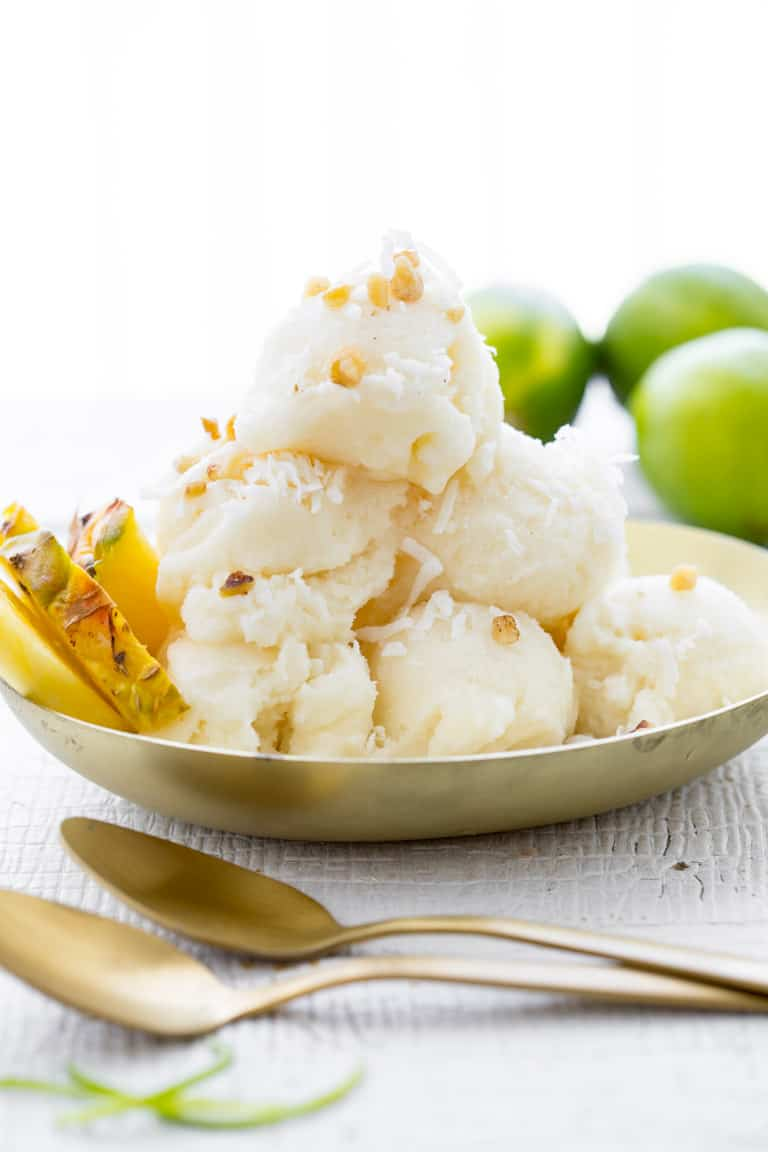 Just in time to help you survive this summer's heatwave meet my refreshingly delicious Pineapple Coconut Sorbet. Super bonus that it is gluten free, and vegan!!
