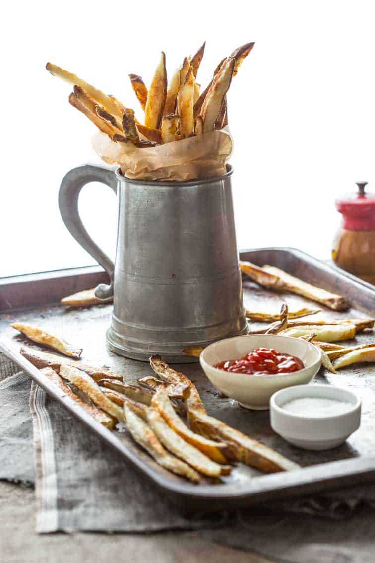 Skinny Oven Fries in a mug with ketchup