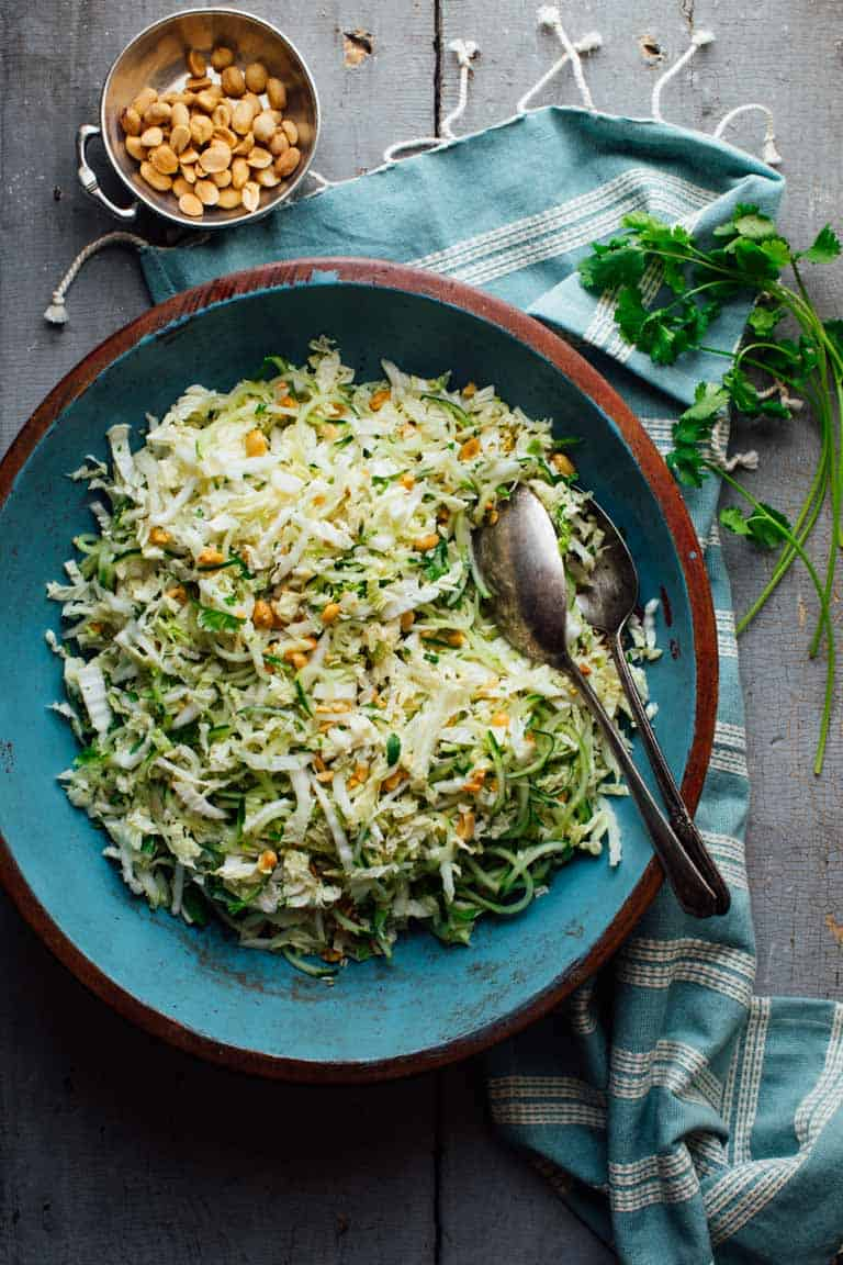This Cucumber and Napa Cabbage Coleslaw is  a yummy, refreshing, #vegan and #lowcarb recipe that will be the star of all your summer cook outs. And it's ready in just 20 minutes! | Healthy Seasonal Recipes #vegetarian #salad #glutenfree