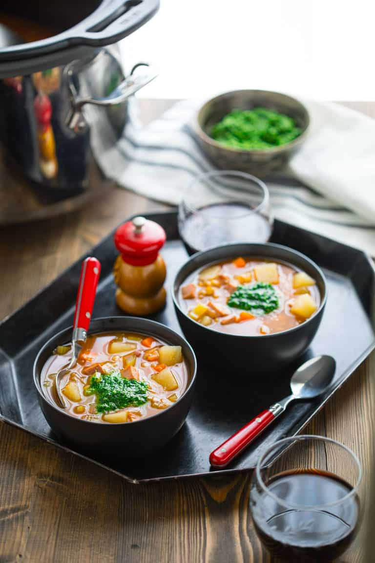 This Slow Cooker Ham Barley Soup with Spinach Pesto is the perfect weeknight vegetable packed delicious dinner. |Healthy Seasonal Recipes | Katie Webster #slowcooker #soup #weeknightdinner #pesto