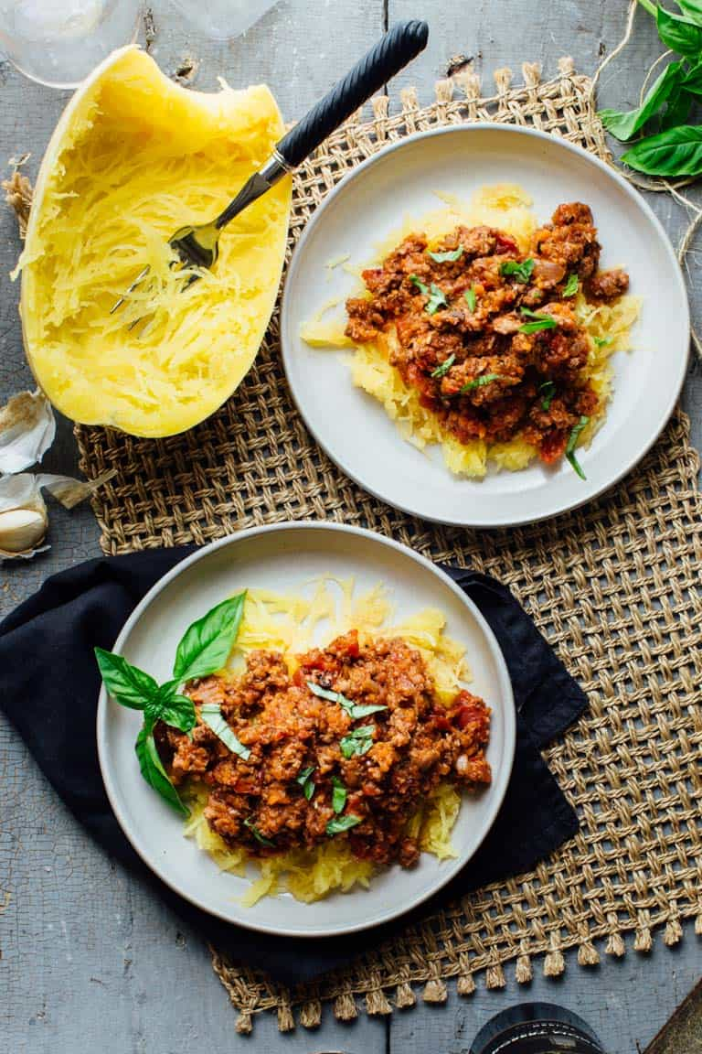 Check out this awesome Spaghetti Squash with Turkey Sausage Ragu. It is ready in just 50 minutes and is gluten free, wheat free and dairy free. | Healthy Seasonal Recipes | Katie Webster