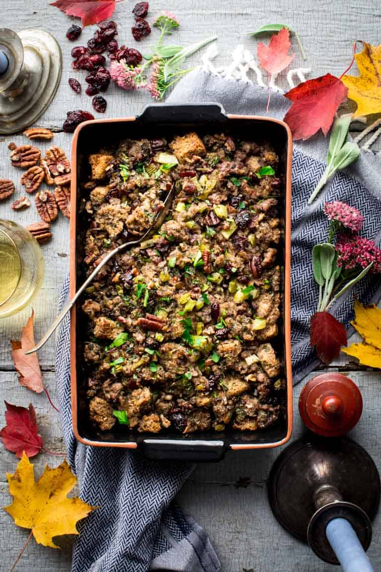 This Cranberry Sausage Stuffing recipe is a delicious and healthy make ahead classic side dish perfect for your Thanksgiving and Holiday table! | Healthy Seasonal Recipes | Katie Webster #Thanksgivingrecipe #sidedish #stuffingrecipe