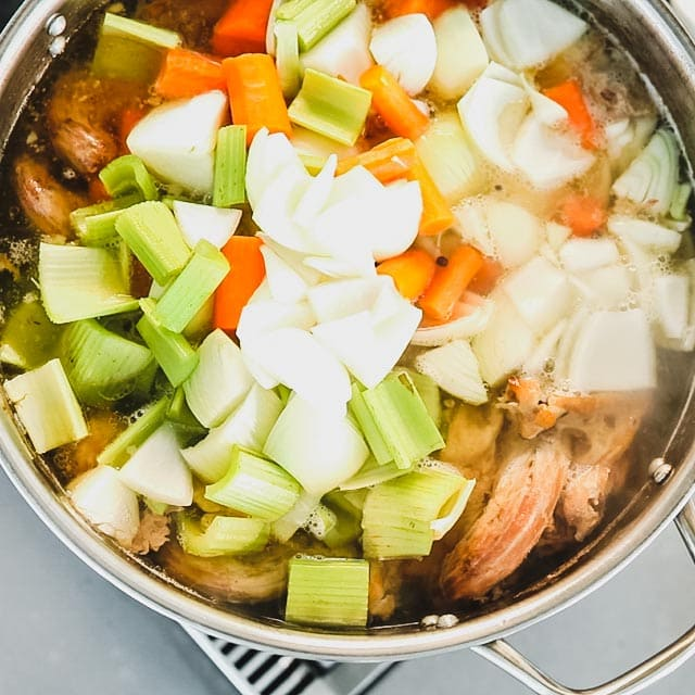 Add the onion, carrot and celery to the stock and simmer for 1 hour.