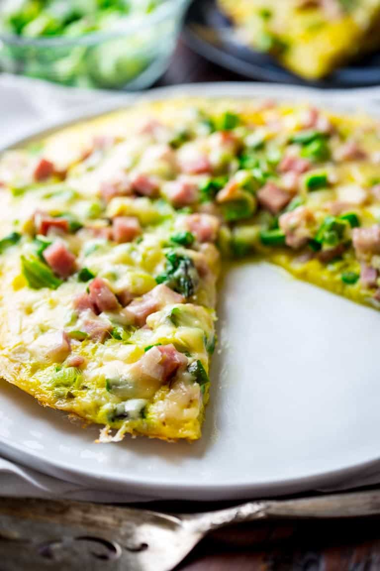 This Frittata with Ham and Asparagus is the perfect Spring meal! Ready in just 20 minutes, only 297 calories per serving, chocked full of 23 grams of protein and super kid friendly. AND you can eat it for breakfast, lunch or dinner. Healthy Seasonal Recipes and Katie Webster