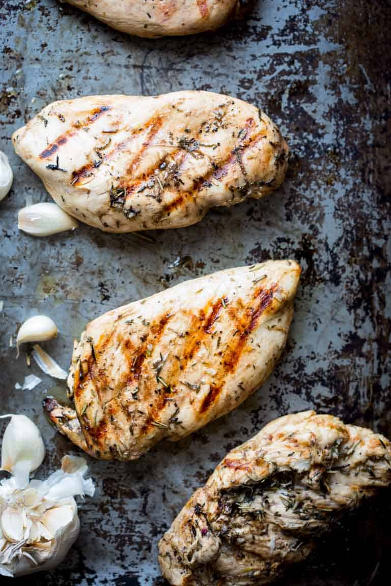 With this Garlic Herb Marinated Chicken recipe you will never have to eat bland dry grilled chicken again! Just 6 ingredients (including salt) and only 20 minutes of prep will give you a gluten-free, dairy-free and low-carb entree that sings with flavor. | Healthy Seasonal Recipes | Katie Webster