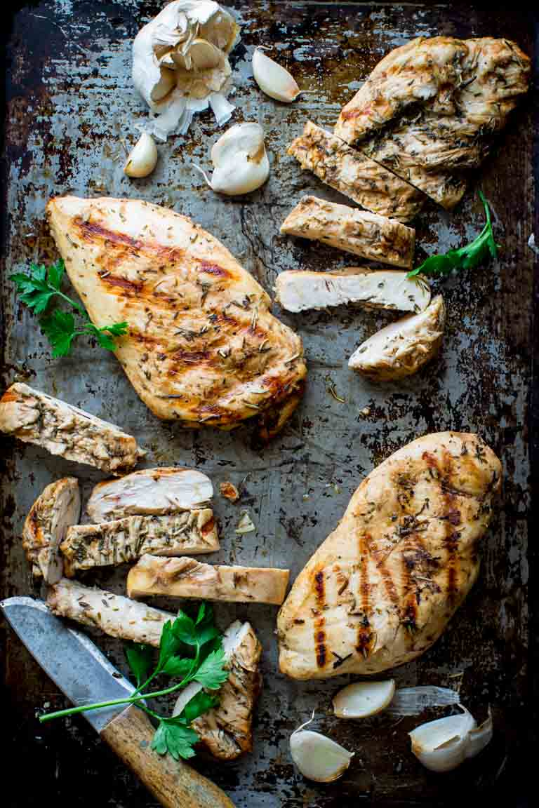 Garlic Herb Grilled Chicken with knife