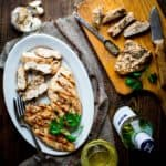With this Garlic Herb Marinated Chicken recipe you will never have to eat bland dry grilled chicken again! Just 6 ingredients (including salt) and only 20 minutes of prep will give you a gluten-free, dairy-free and low-carb entree that literally sings with flavor. | Healthy Seasonal Recipes | Katie Webster