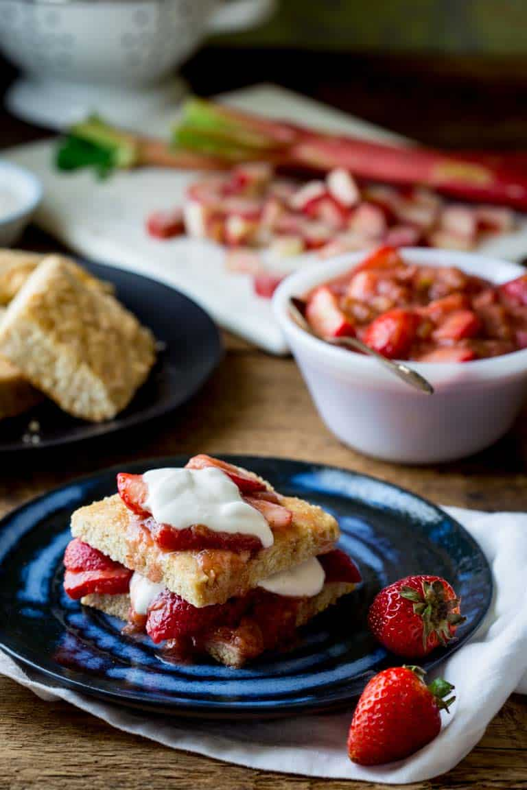 These Strawberry Rhubarb Shortcakes are a make-ahead healthier twist on the classic recipe. The perfect summer dessert showcasing the magical combination of strawberries and rhubarb! | Healthy Seasonal Recipes | Katie Webster