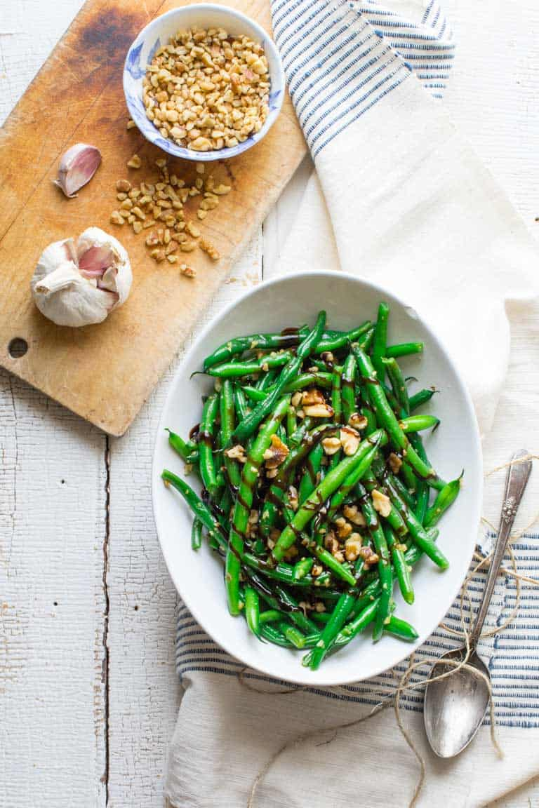 balsamic green beans with walnuts on towel