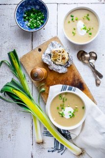 This Roasted Garlic Cheddar Soup will literally warm you up from the inside out! It is filled with yummy cheddar cheese and roasted garlic making it the perfect Winter comfort food and gluten free meal! | Healthy Seasonal Recipes | Katie Webster