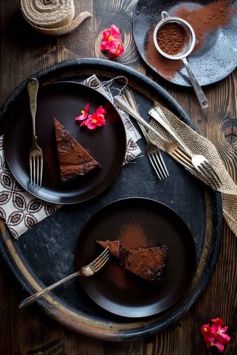 Flourless Chocolate Cake slices on black plates
