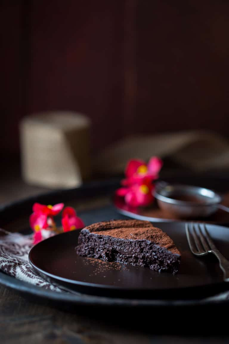 Flourless Chocolate Cake slice on a black plate