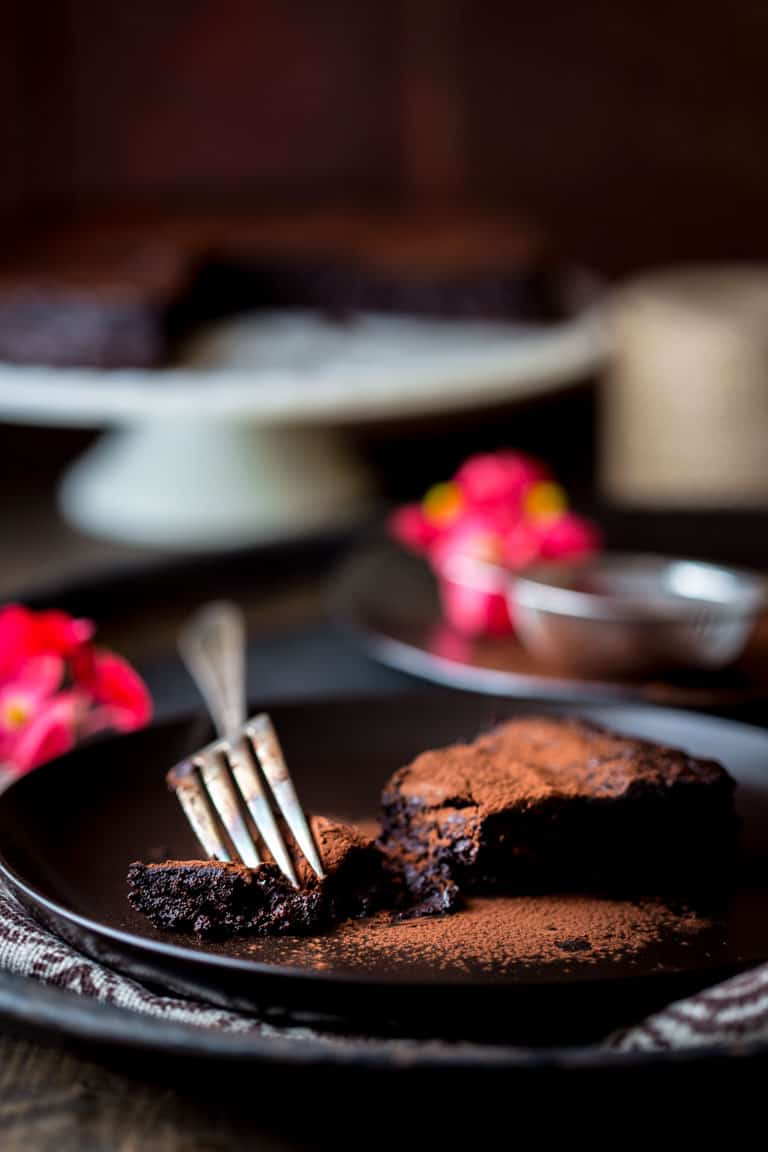 slice of Flourless Chocolate Cake on a black plate