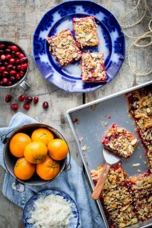 cranberry crumb bars on a gray table