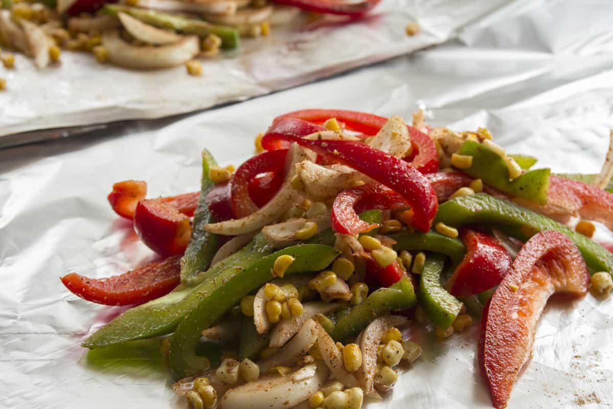 the fajita veggies on foil before grilling