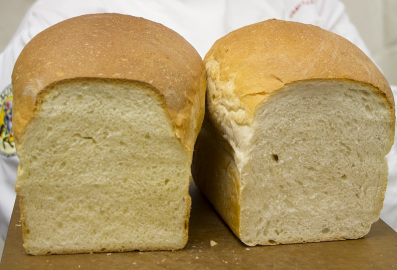 Two loaves of bread made with the same recipe. Left:made with King Arthur Flour unbleached All-purpose, Right: made with store-brand bleached all-purpose.