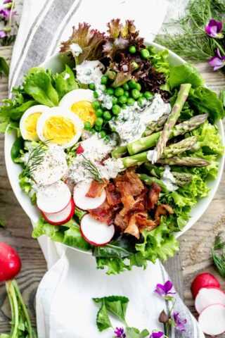 overhead of composed salad with dressing on it