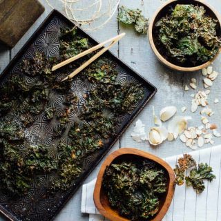 Garlic Almond Kale Chips are a gluten-free and vegan Super Snack that are ready in just 30 minutes and will literally knock your socks off! | Healthy Seasonal Recipes | Katie Webster