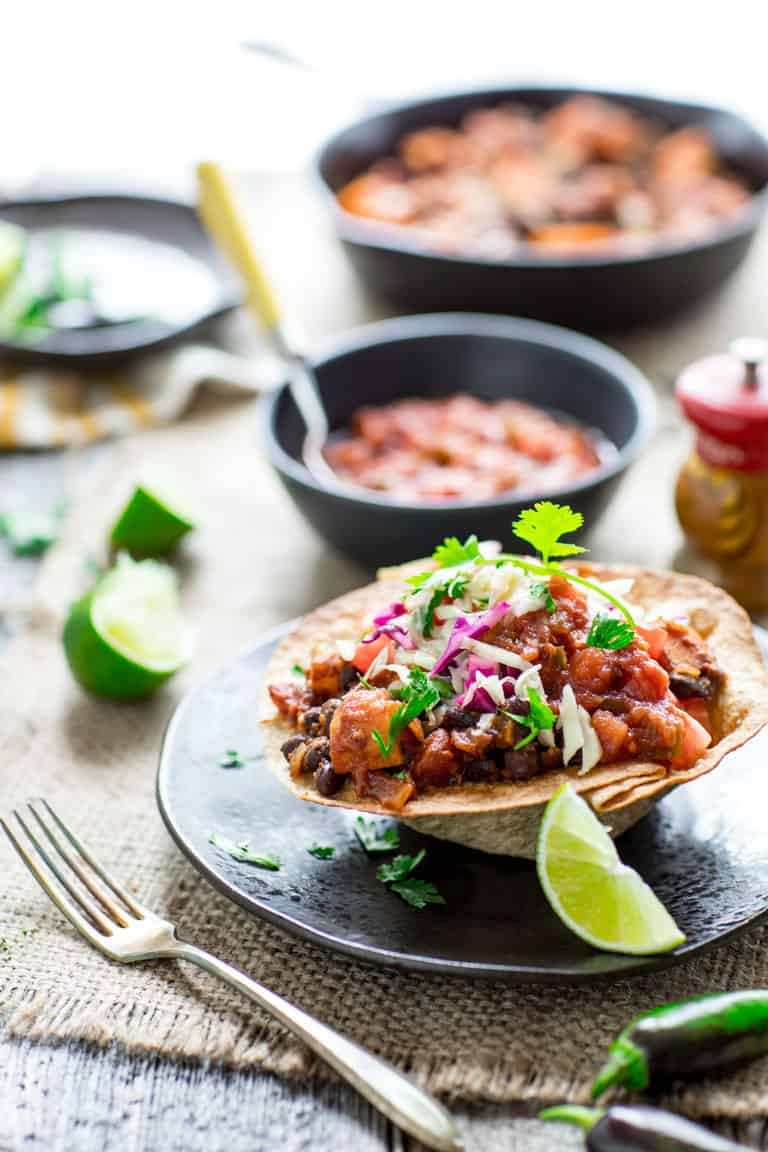 These Sweet potato and Black Bean Chili Tortilla Bowls give you all the nutrition and yumminess from the veggie packed high fiber filling without needing a huge tortilla to wrap it all up.  It is vegetarian comfort food at it's best! | Healthy Seasonal Recipes | Katie Webster