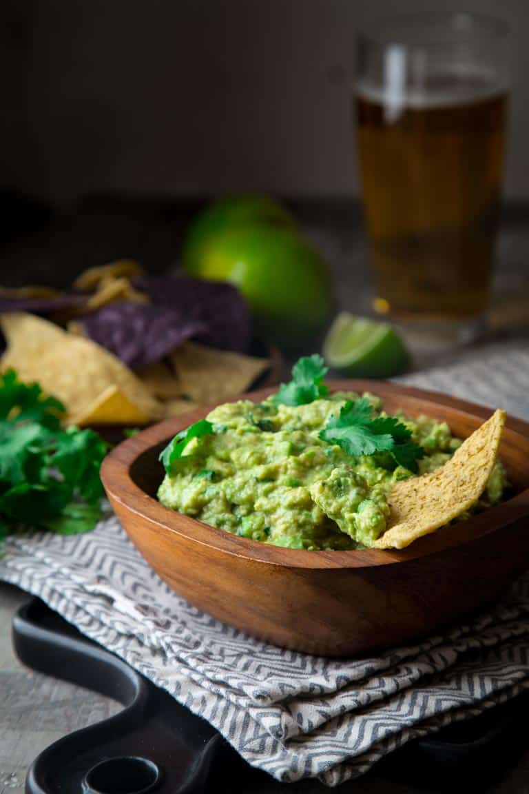 I'm here with my super quick {ready in just 10 minutes!} and utterly delicious guacamole recipe. Check out my 6 Tips for the Best Classic Guacamole. | Healthy Seasonal Recipes | Katie Webster | #glutenfree #superbowl #appetizer