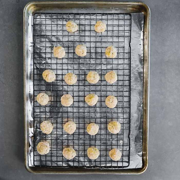Line a sheet pan with foil and set a rack on top. Spray with cooking spray. Set the meatballs on a c