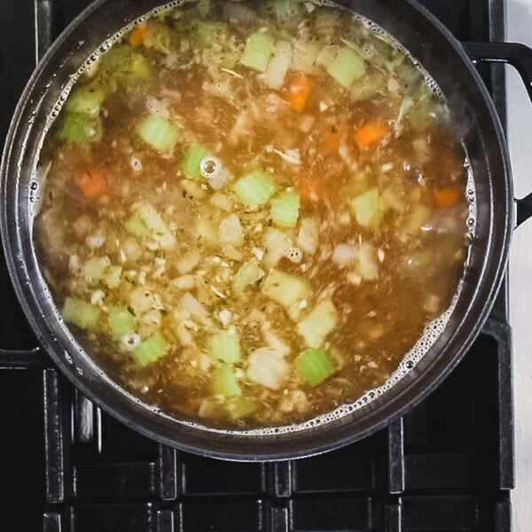 Add broth and bring to a simmer.