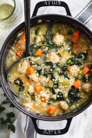 a black Dutch Oven filled with Wedding Soup