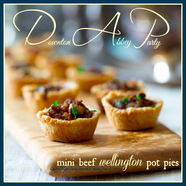 mini beef wellington pot pies on a cutting board