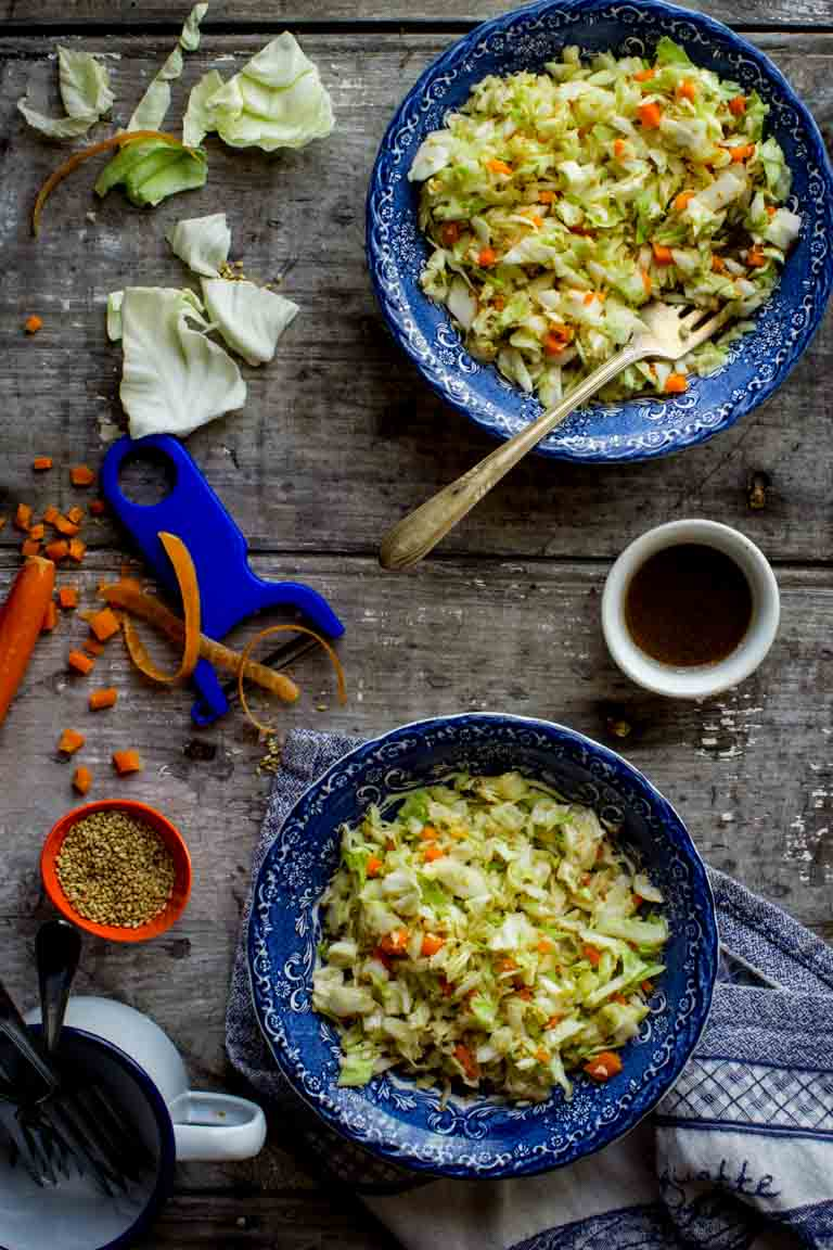 I promise this Sesame Coleslaw will be your go-to salad this Summer. You can whip it up in just 15 minutes and the super yummy Asian flavored dressing turns the crunchy cabbage and carrots into a mouth-watering bite. Not to mention it is Vegan, Paleo and Gluten-Free!   Healthy Seasonal Recipes   Katie Webster