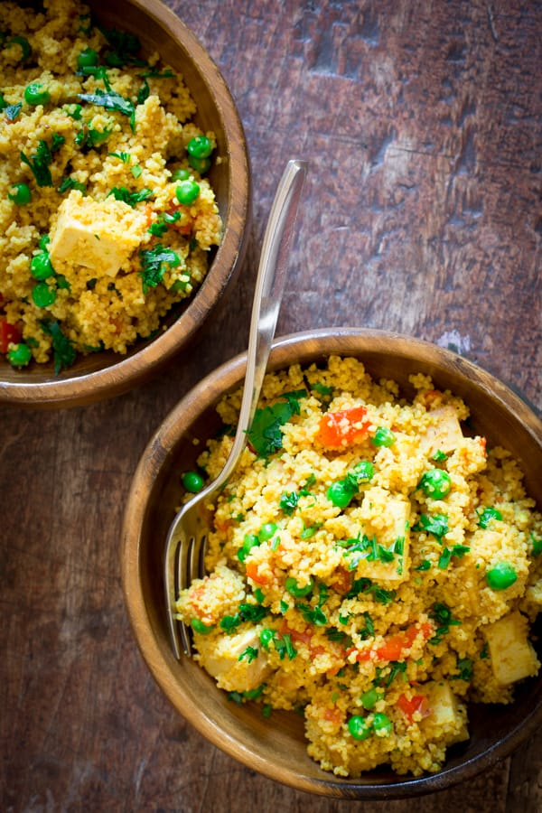 Curried couscous with roasted red peppers peas and tofu
