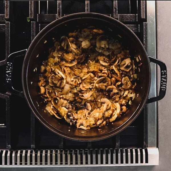Add the mushrooms, salt, pepper and thyme and saute until the mushrooms are reduced down and most of the liquid is evaporated, about 5 to 7 minutes.