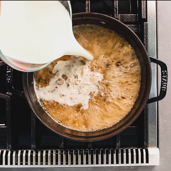 Add milk and return to a simmer, stirring often.