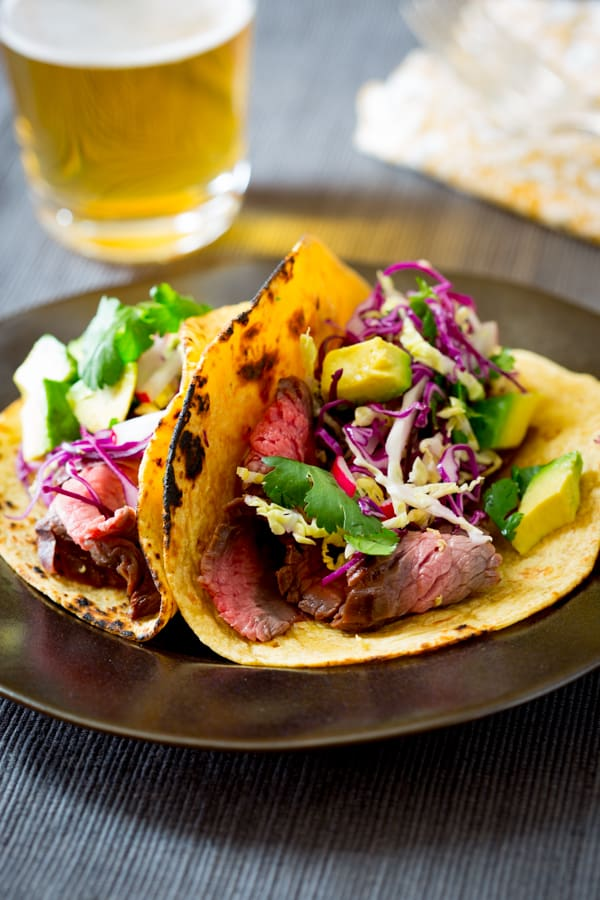 chipotle and maple flank steak tacos with zippy cabbage slaw