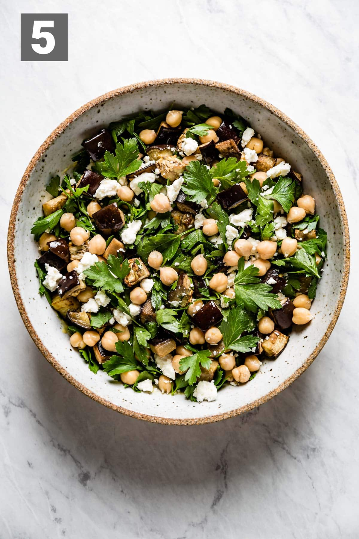 mix the eggplant, parsley, and chickpeas into the dressing