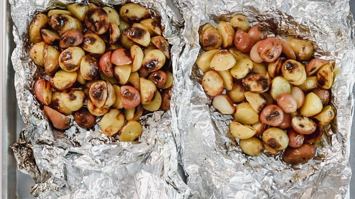 open packets of grilled potatoes