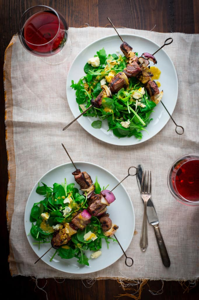 Spinach Salad with Steak, onion and date Kebabs with orange and blue cheese on healthyseasonalrecipes.com