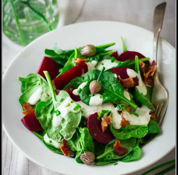 spinach salad with maple ranch dressing, bacon and beets