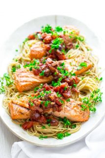 Healthy Grilled Salmon Puttanesca with Garlic tomato sauce with olives and capers. @healthyseasonal