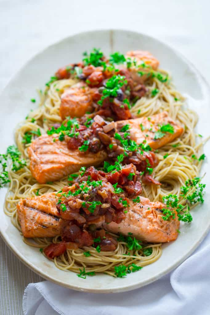 Grilled Salmon Puttanesca on HealthySeasonalRecipes.com #paleo #glutenfree