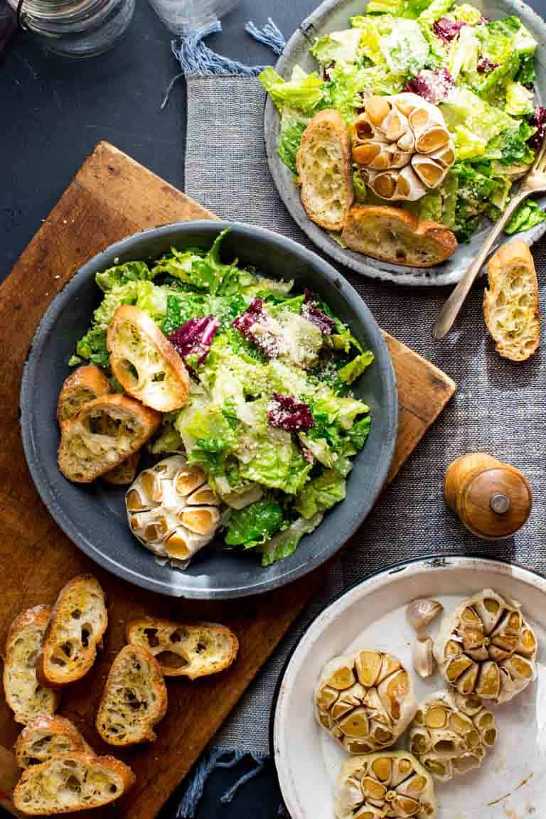 Garlic Lover's Roasted Garlic Caesar Salad, with roasted garlic in the dressing and a whole head of roasted garlic to go on each serving! The dressing is egg-free and it has capers in it!! | Healthy Seasonal Recipes | Katie Webster